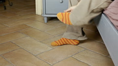 Feet morning colorful socks scratch Stock Footage