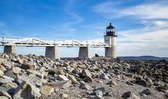 Marshall Point Lighthouse as seen from the rocks in Port Clyde, Maine - stock photo
