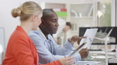 4K Portrait smiling research engineer working in office with colleagues Stock Footage