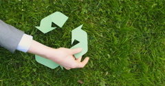 Hand Creates a Recycling Symbol Stock Footage