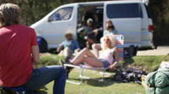 4K Hipster group with camper van having fun at music festival campsite - stock footage