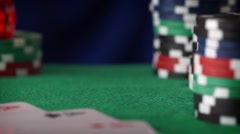 Red dice rolls, casino chips, cards on green felt Stock Footage