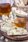 Cranberry and pistachio biscotti with vin santo wine - stock photo