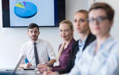 young business people group on team meeting at modern office - stock photo