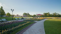 Excavation in the park on a path past the flower beds Stock Footage