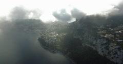 CINEMAITC AERIAL FLY THROUGH BEAUTIFUL RAIN CLOUDS OVER BLUE OCEAN - stock footage