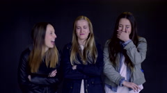Serious Teens Cross Their Arms, Girl Cracks Up Laughing, They All Laugh Stock Footage