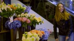 Teen Points To A Bouquet Of Hydrangeas, Then Smells Flowers And Walks Off-Camera Stock Footage
