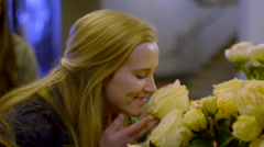 Girl Splits Off From Friends To Smell A Rose, She Smiles And Points To It - stock footage