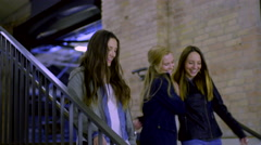 Friends Walk Down Stairwell, They Joke And Laugh, Girl Hugs Her Friend Stock Footage