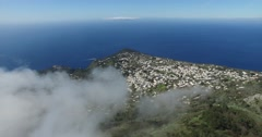 EPIC CINEMATIC REVERSE SHOT OF SCENIC CLOUDS AND CAPRI LANDSCAPE Stock Footage