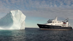 A large iceberg and the ship in the Arctic. Stock Footage