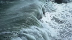Wild storm wave crashes against rocky shore Stock Footage