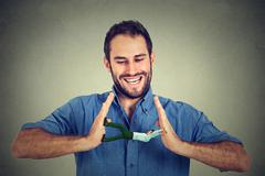 Conceptual creative shot of a man between hands of a laughing smiling guy Stock Photos
