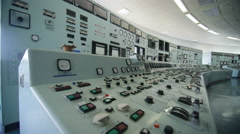 4K Interior view of system control panel in power plant control room. No people. - stock footage