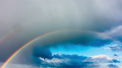 Rainbow in the sky after the rain, time-lapse Stock Footage