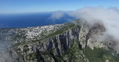 CINEMATIC FLY THROUGH EPIC CLOUDS AT TOP OF TOURIST MOUNTAIN Stock Footage