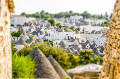 Scenic view of Alberobello and trulli, Italy. Tilt-shift effect applied - stock photo