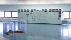 4KWorkers in power plant control room looking at control panel & checking system - stock footage