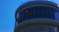 Window Washers on a Office Building. Industrial climbers  Make Facade Cleaning Stock Footage