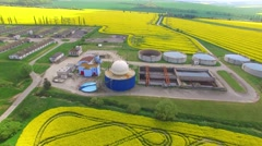Biogas plant from pig farm in green fields. Stock Footage