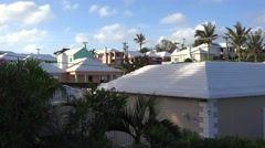 Typical Bermuda colourful houses with a white roof to collect rainwater. Stock Footage