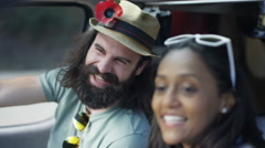 4K Happy hipster couple chatting & laughing in vehicle on road trip Stock Footage