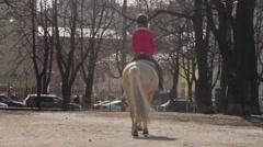 Little girl riding a light horse - stock footage