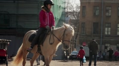 Horseback riding - little 11-year old girl riding a horse Stock Footage