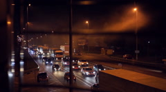 Megalopolis road at night, heavy traffic. Dense smog floating in air, pollution - stock footage