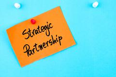 Strategic Partnership written on orange paper note - stock photo