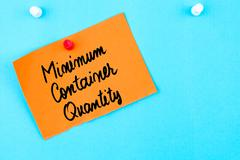 Minimum Container Quantity written on orange paper note - stock photo