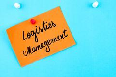 Logistics Management written on orange paper note Stock Photos