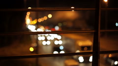 Cars on busy road, defocused traffic lights trembling because of air pollution - stock footage