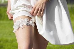 Beautiful wedding garter on the leg of a bride Stock Photos