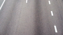 Grey asphalt and fast-moving cars at autobahn highway, speeding, view from above - stock footage