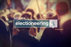 Electioneering - web search box glossary term - stock photo