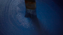 Artist Painting a Blue Picture in Slow Motion - stock footage