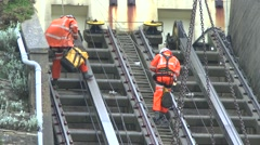 2 Engineers Descending To Cable Cars Damaged In Cliffs Landslide - stock footage