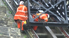 Engineers Inspecting Cable Cars Damaged In Cliffs Landslip Stock Footage