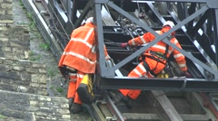 Engineers Inspecting Damage To Cable Cars In Cliffs Landslide - stock footage
