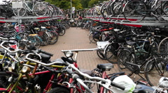 Cyclist at Bike Park at Central Station - The Hague Netherlands Stock Footage
