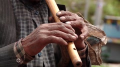 Video footage of a busker in a village in Peru. Close up to the hands playing a Stock Footage