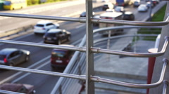 Line of cars moving slowly on road, one of drivers pulls over to fix a problem - stock footage