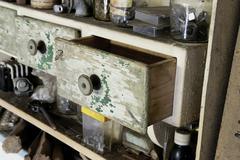 Vintage old wooden drawer in cupboard in workshop. Stock Photos