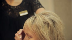 hairdresser makes hair of woman - stock footage