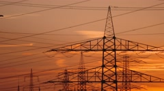Electrical towers with a sunset in germany Stock Footage