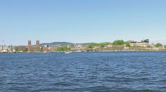 Sailing toward Oslo harbor next to the fort Stock Footage