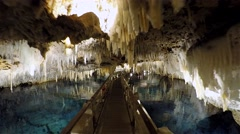 Pass over the floating pontoon pathway in the Crystal Cave, Bermuda. Timelapse - stock footage