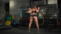 beautiful sporty woman doing squat workout in gym - stock footage